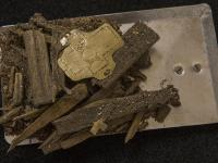 Parts of the wooden box relic with a golden plate